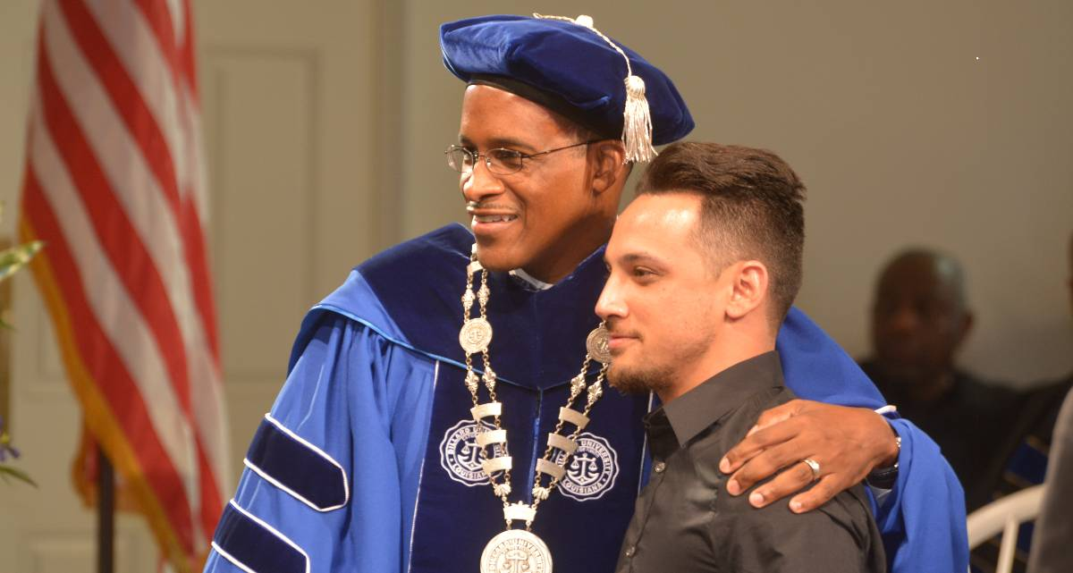 Dr. Walter M. Kimbrough at Honors Convocation with student